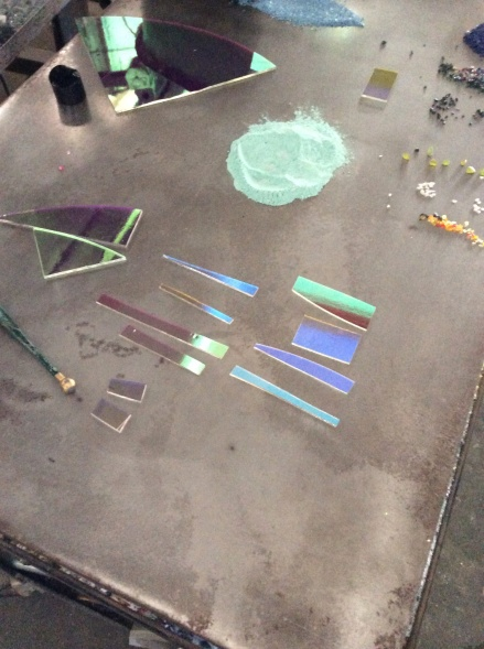 Dichroic being sized and cut to be put into 980 degree pick up box kiln